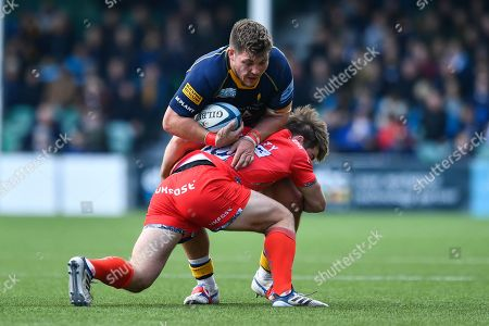 Ethan Waller of Worcester Warriors is tackled by AJ MacGinty of Sale Sharks