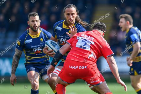 Anton Bresler of Worcester Warriors is tackled by Rob Webber of Sale Sharks- Mandatory by-line: Craig Thomas/JMP