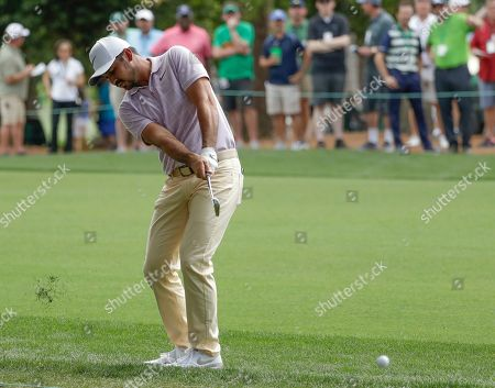 Jason Day, of Australia, hits to the first green during the third round for the Masters golf tournament, in Augusta, Ga
