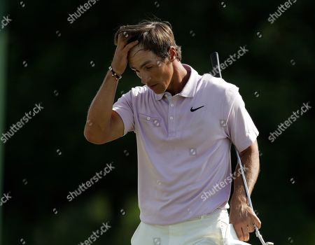 Thomas Pieters, of Belgium, reacts on the 18th hole during the third round for the Masters golf tournament, in Augusta, Ga