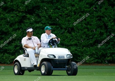 Kiradech Aphibarnrat, of Thailand, gets a ride on the 13th hole after having to go back and hit a second drive during the third round for the Masters golf tournament, in Augusta, Ga