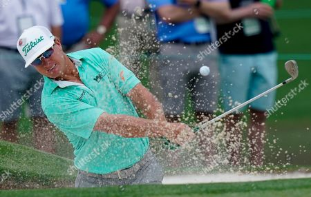 Charley Hoffman hits from a bunker on the second hole during the third round for the Masters golf tournament, in Augusta, Ga