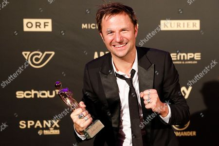 Stock Picture of Philipp Hochmair poses with his Romy award for the most popular actor in TV series during the Romy Gala television award ceremony at the Hofburg palace in Vienna, 13 April 2019.