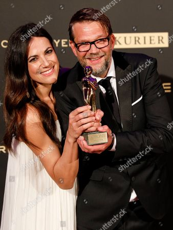 Bettina Zimmermann (L) und German actor Kai Wiesinger pose with their Romy award for the best digital short show during the Romy Gala television award ceremony at the Hofburg palace in Vienna, 13 April 2019.