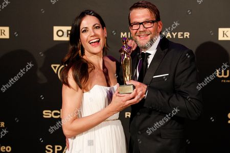 Stock Image of Bettina Zimmermann (L) und German actor Kai Wiesinger pose with their Romy award for the best digital short show during the Romy Gala television award ceremony at the Hofburg palace in Vienna, 13 April 2019.