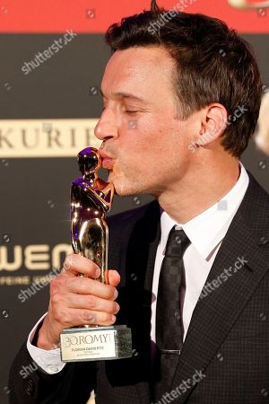 Florian David Fitz poses with his Romy award for the best screenplay during the Romy Gala television award ceremony at the Hofburg palace in Vienna, 13 April 2019.