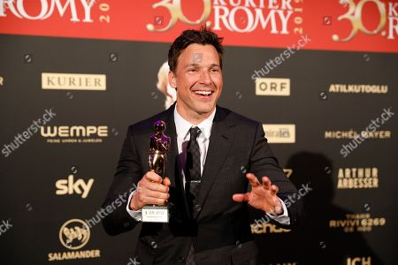 Stock Picture of Florian David Fitz poses with his Romy award for the best screenplay during the Romy Gala television award ceremony at the Hofburg palace in Vienna, 13 April 2019.