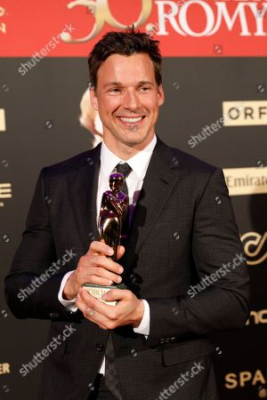 Stock Image of Florian David Fitz poses with his Romy award for the best screenplay during the Romy Gala television award ceremony at the Hofburg palace in Vienna, 13 April 2019.