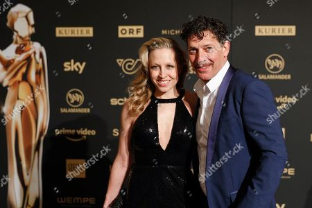 Nina Proll (L) and her husband Austrian actor Gregor Bloeb (R) arrive for the Romy Gala television award ceremony at the Hofburg palace in Vienna, 13 April 2019.