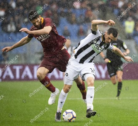 Roma's Ivan Marcano (L) and Udinese's Emil Hallfredsson during the Serie A soccer match Roma-Udinese at Olimpico Stadium in Rome, Italy, 13 April 2019.