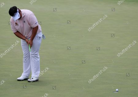 Kiradech Aphibarnrat of Thailand putts on the second hole during the third round of the 2019 Masters Tournament at the Augusta National Golf Club in Augusta, Georgia, USA, 13 April 2019. The 2019 Masters Tournament is held 11 April through 14 April 2019.