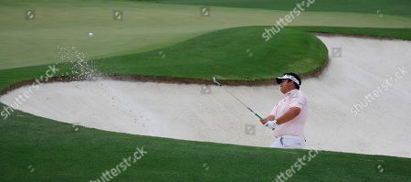 Kiradech Aphibarnrat of Thailand hits from a bunker on the second hole during the third round of the 2019 Masters Tournament at the Augusta National Golf Club in Augusta, Georgia, USA, 13 April 2019. The 2019 Masters Tournament is held 11 April through 14 April 2019.