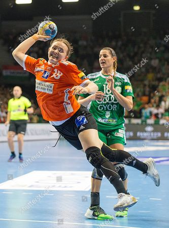 Sara Trier Hald (L) of Odense in action during the women's EHF Champions League quarterfinal second leg handball match between Gyori Audi ETO KC and Odense Handbold in Gyor, 120 kms west of Budapest, Hungary, 13 April 2019.