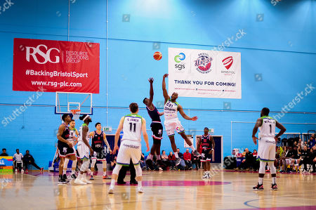 Daniel Edozie of Bristol Flyers and Willie Clayton of Manchester Giants contend for the ball