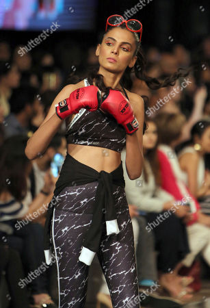 Stock Picture of A Pakistani model presents creation by a designer Nomi Ansari during the Sunsilk Fashion Week in Lahore, Pakistan