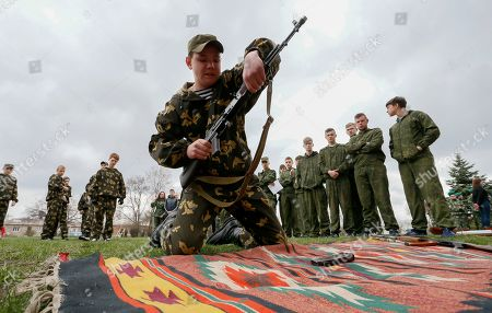 School children take part in a military game at the pro-Russian militant's controlled Makeevka city of Donetsk area, Ukraine, 13 April 2019. The military game named 'I's a patriot' consists of physical and fight parts like obstacle course, assembly and disassembly of the submachine gun and so on. Russia has sent up to 10 transportation platforms with T-72 tanks and four Grad multiple launch rocket systems (MLRS) to the Donbas, eastern Ukraine as local media report.
