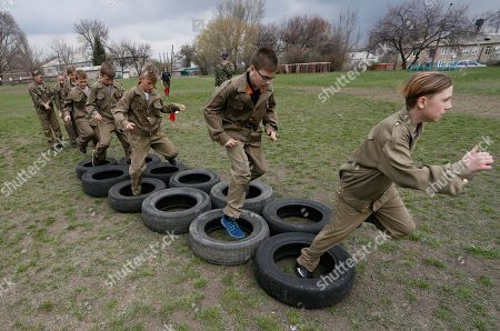 Editorial picture of Crisis in Ukraine - military game with school children, Donetsk - 13 Apr 2019