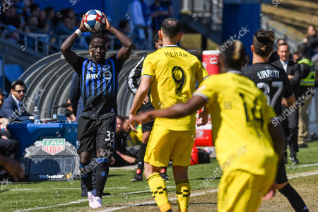 Montreal Impact defender Bacary Sagna (33) puts the ball back into play during the Columbus Crew SC at Montreal Impact game at Saputo Stadium in Montreal, Quebec