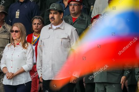 President of Venezuela Nicolas Maduro (C) and first lady Cilia Flores (L) attend the commemoration of the 17th anniversary of the failed coup d'etat against the late Venezuelan President Hugo Chavez and the tenth anniversary of the Bolivarian Militia in Caracas, Venezuela, 13 April 2019. Maduro presided over an event at Paseo los Proceres, a square dedicated to the heroes of the emancipation of Venezuela, to commemorate the 17th anniversary of the return to power of late former President Hugo Chavez (1999-2013).