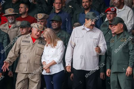 President of Venezuela Nicolas Maduro (2-R), next to the first lady Cilia Flores (2-L), Defense Minister Vladimir Padrino Lopez (R), and president of the National Constituent Assembly Diosdado Cabello (L) attend the commemoration of the 17th anniversary of the failed coup d'etat against the late Venezuelan President Hugo Chavez and the tenth anniversary of the Bolivarian Militia in Caracas, Venezuela, 13 April 2019. Maduro presided over an event at Paseo los Proceres, a square dedicated to the heroes of the emancipation of Venezuela, to commemorate the 17th anniversary of the return to power of late former President Hugo Chavez (1999-2013).