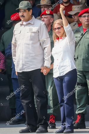 President of Venezuela Nicolas Maduro (L) and first lady Cilia Flores (R) attend the commemoration of the 17th anniversary of the failed coup d'etat against the late Venezuelan President Hugo Chavez and the tenth anniversary of the Bolivarian Militia in Caracas, Venezuela, 13 April 2019. Maduro presided over an event at Paseo los Proceres, a square dedicated to the heroes of the emancipation of Venezuela, to commemorate the 17th anniversary of the return to power of late former President Hugo Chavez (1999-2013).