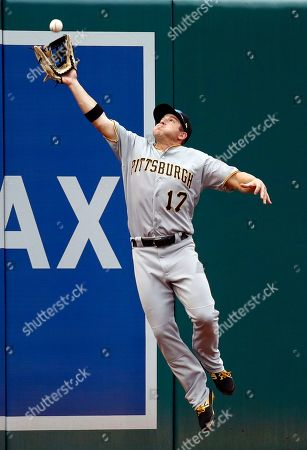 Pittsburgh Pirates left fielder JB Shuck catches a fly ball that was hit by Washington Nationals' Matt Adams in the fourth inning of a baseball game, in Washington