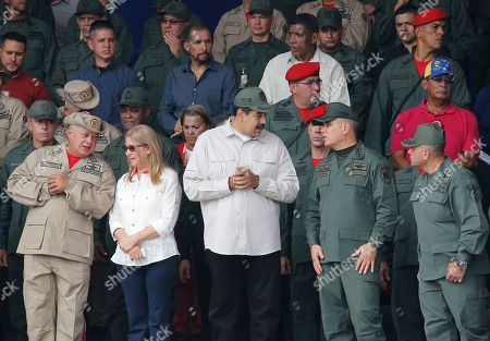 Nicolas Maduro, Diosdado Cabello, Cilia Flores, Remigio Ceballos. From left to right, front line, Diosdado Cabello, Venezuela's socialist party boss and president of the National Constituent Assembly speaks to first lady Cilia Flores, as Venezuela's President Nicolas Maduro speaks to Defense Minister Vladimir Padrino Lopez and on the right corner Admiral Remigio Ceballos, Chief of Staff of the Armed Forces Strategic Operational Command during the tenth anniversary celebration of the Bolivarian militia in Caracas, Venezuela, . Officially known as the Venezuelan National Bolivarian Militia, it is a branch of the National Armed Forces of Venezuela created by the late President Hugo Chavez and today it is made up by 2.199.000 men and women