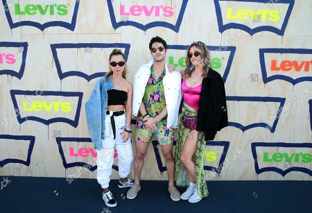 Ashley Weston, Darren Criss, Mia Swier. Ashley Weston, from left, Darren Criss and Mia Swier are seen at the Levi's Party in the Desert, in Indian Wells, Calif