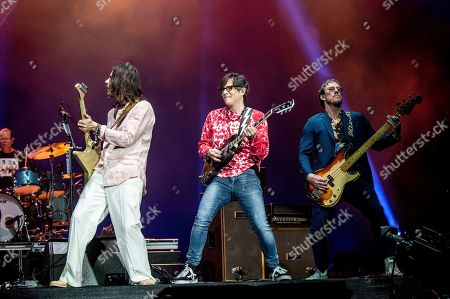 Brian Bell, Rivers Cuomo, Scott Shriner. Brian Bell, from left, Rivers Cuomo, and Scott Shriner of Weezer perform at the Coachella Music & Arts Festival at the Empire Polo Club, in Indio, Calif