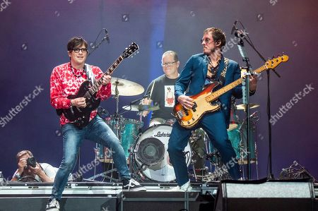 Rivers Cuomo, Scott Shriner. Rivers Cuomo, left, and Scott Shriner of Weezer perform at the Coachella Music & Arts Festival at the Empire Polo Club, in Indio, Calif