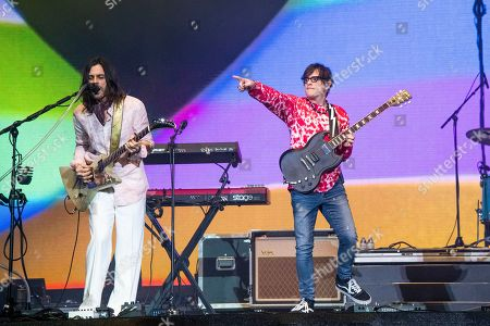 Brian Bell, Rivers Cuomo. Brian Bell, left, and Rivers Cuomo of Weezer performs at the Coachella Music & Arts Festival at the Empire Polo Club, in Indio, Calif