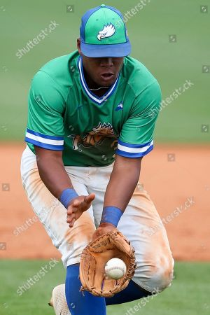 Jay Hayes (30) fields the ball during a Florida Gulf Coast at Kennesaw State baseball game, in Kennesaw, Ga