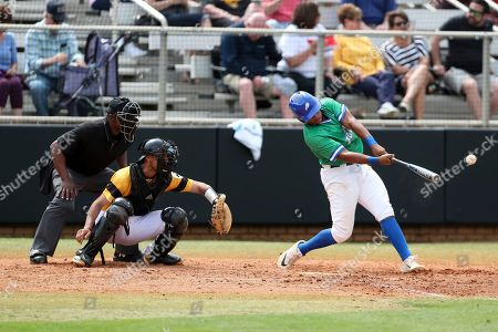Jay Hayes (30) makes a hit during a Florida Gulf Coast at Kennesaw State baseball game, in Kennesaw, Ga