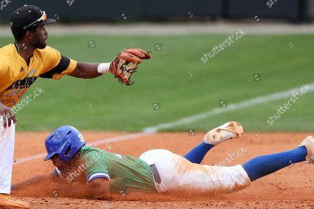 Stock Photo of Jay Hayes (30) slides into third base before Jaylen Smith (3) receives the ball during a Florida Gulf Coast at Kennesaw State baseball game, in Kennesaw, Ga