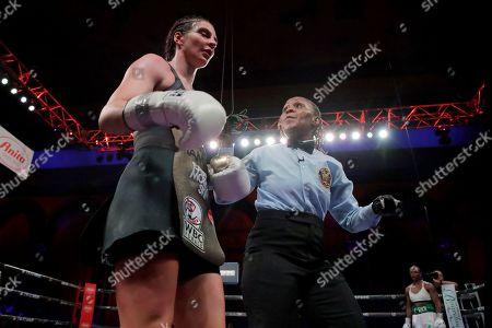 Referee Sparkle Lee, right, talks to Christina Hammer after Hammer lost her mouthpiece during the eighth round of the women's middleweight championship boxing bout against Claressa Shields, in Atlantic City, N.J. Shields won by unanimous decision