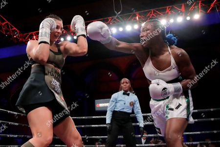 Claressa Shields, right, throws a right at Christina Hammer during fourth the round of the women's middleweight championship boxing bout, in Atlantic City, N.J