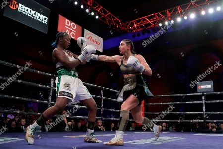 Christina Hammer, right, throws a right at Claressa Shields during the seventh round of the women's middleweight championship boxing bout, in Atlantic City, N.J. Shields won by unanimous decision