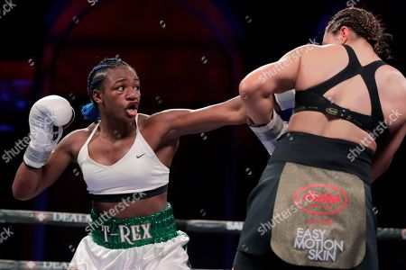 Claressa Shields, left, throws a left at Christina Hammer during the second round of the women's middleweight championship boxing bout, in Atlantic City, N.J. Shields won by unanimous decision