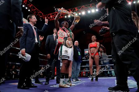 Claressa Shields holds her belts after defeating Christina Hammer during the women's middleweight championship boxing bout, in Atlantic City, N.J. Shields won by unanimous decision
