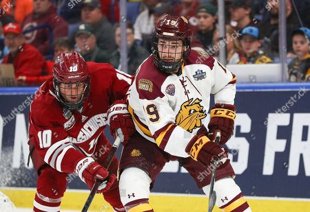 Stock Image of Minnesota-Duluth Bulldogs forward Justin Richards (19) and Massachusetts Minutemen forward Jack Suter (10) skate during the second period of play in the NCAA Frozen Four Men's Hockey National Championship game between the Massachusetts Minutemen and Minnesota-Duluth Bulldogs at the KeyBank Center in Buffalo , N.Y. (Nicholas T. LoVerde/Cal S\pfport Media)