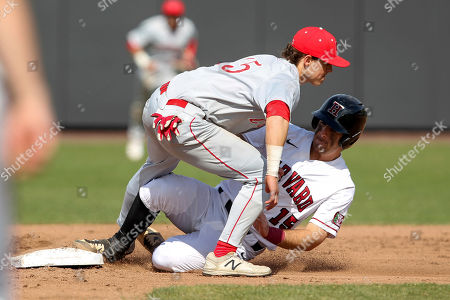 Harvard's Jake Suddleson, right, slides safely into second base ahead of the tag by Cornell's Matt Collins, left, during an NCAA college baseball game, in Boston