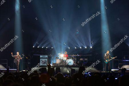 Stock Image of Muse - Matt Bellamy, Dominic Howard and Chris Wolstenholme