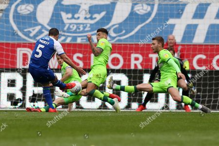 Ben Godfrey of Norwich City handles the ball after a shot from Sam Morsy of Wigan Athletic