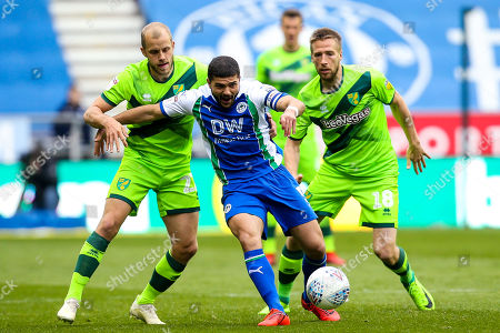 Sam Morsy of Wigan Athletic takes on Teemu Pukki of Norwich City