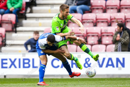Marco Stiepermann of Norwich City takes on Sam Morsy of Wigan Athletic