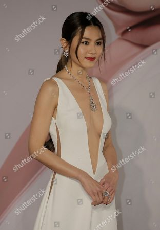 Stock Photo of Hong Kong actress Chrissie Chau poses with his wife on the red carpet of the Hong Kong Film Awards in Hong Kong