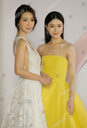 Stock Picture of Janice Man, Fiona Sit. Hong Kong actress Janice Man, right, and Fiona Sit pose on the red carpet of the Hong Kong Film Awards in Hong Kong