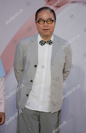 Stock Picture of Hong Kong director Fruit Chan poses on the red carpet of the Hong Kong Film Awards in Hong Kong