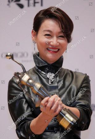 """Hong Kong actress Kara Wai poses after winning the Best Supporting Actress of her movie """"Tracey"""" at the Hong Kong Film Awards in Hong Kong"""