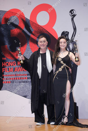 "Chinese actress Chloe Maayan, right, and Hong Kong actor Anthony Wong pose after winning the Best Actress and Best Actor of their movie ""Three Husbands"" and movie ""Still Human"" at the Hong Kong Film Awards in Hong Kong"